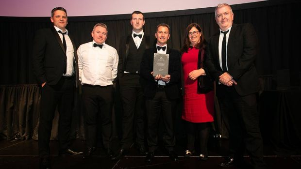 Stephen Pierce, National Sales Manager, Ireland, Vescom Wallcoverings & Fabrics presents the Building Refurbishment for a Single Building or Development award to the Pure Fitout & O'Donnell O'Neill Teams.