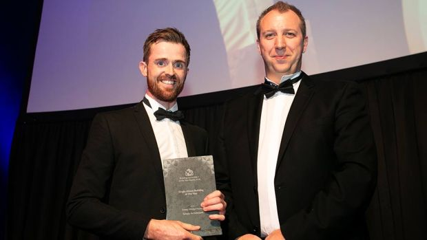 Ronan Holohan, Managing Director, MILLIMETRE DESIGN presents the Single House Building of the Year award to Gareth Sullivan, Simply Architecture.