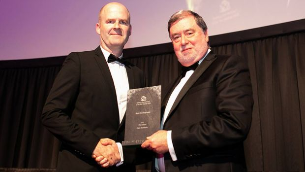 Derry Scully, Group President, Linesight presents the Best Development award to Dermot Harrington, Cook Architects.