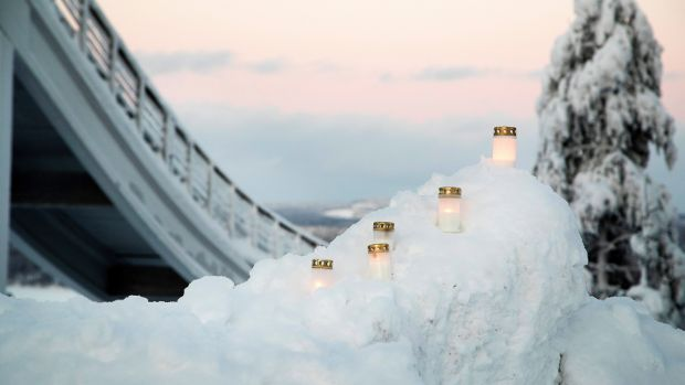 Candles at a memorial in the Laajavuori ski resort in Jyvaskyla, Finland. Photo: Mauri Ratilainen/EPA