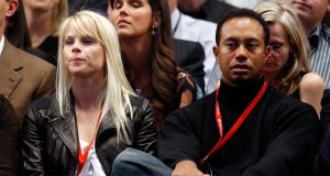 Tiger Woods and wife Elin watch as Pete Sampras and Roger Federer of Switzerland play an exhibition match at Madison Square Garden in New York City in 2008. A year later the scandl broke around Woods. Photo: Nick Laham/Getty Images