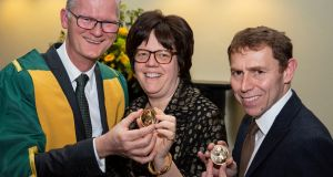 Prof Peter Kennedy, president of the Royal Irish Academy with the recipients of the academy's gold medals, sponsored by the Higher Education Authority, architectural historian, Prof Kathleen James-Chakraborty and astrophysicist, Prof Stephen J Smartt. Photograph: Johnny Bambury