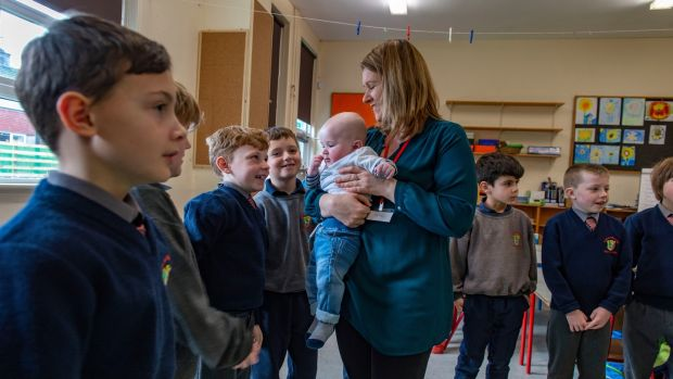 Parent Lisa Crowley and 6-month-old Dave, and students in Scoil na mBuachaillí, Clonakilty, taking part in the Roots of Empathy programme. Photograph: Michael Mac Sweeney/Provision