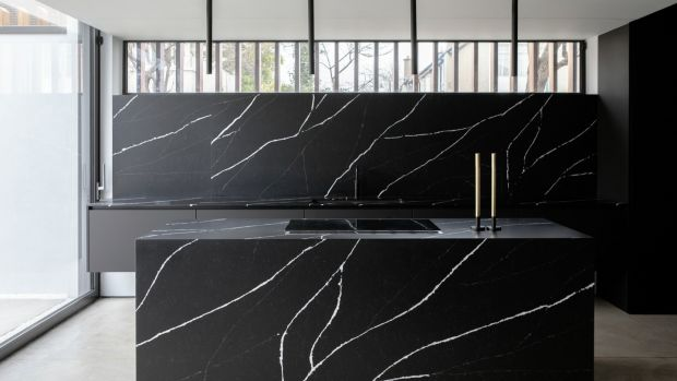 The workspace is clad in manquina marble, a manmade Silestone from Constantina, a manufactured product that makes it look like a monolith. Photograph: Ruth Maria Murphy