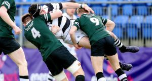 Belvedere's Cormac Yalloway is tackled by Diarmuid Mangan and Jack Doyle of Newbridge. Photograph: Bryan Keane/Inpho