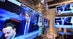 Minister for Health Simon Harris pictured in the Dail earlier this week, on televisions in Arnotts in Dublin. Photograph: Alan Betson / The Irish Times