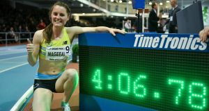 Ireland's Ciara Mageean  celebrates her  new 1,500m indoor Irish record of 4:06.78   at the Athlone International Grand Prix. Photograph:  Brendan Moran/Sportsfile