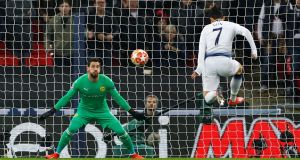 Tottenham's Son Heung-min scores their first goal in the  Champions League round of 16 first leg against  Borussia Dortmund at Wembley. Photograph: Eddie Keogh/Reuters