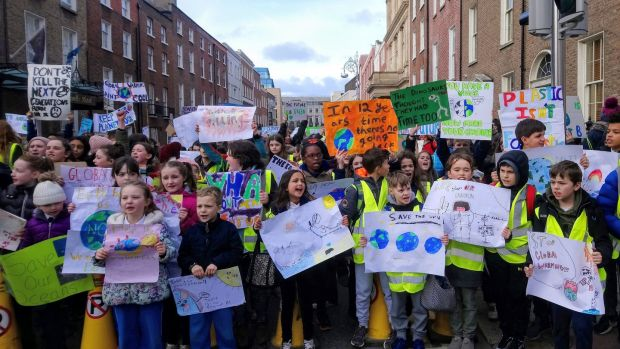Schoolchildren protesting near Leinster House in Dublin, calling on the Government to take action on climate change. Photograph: Nell Mercier/PA Wire