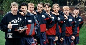 Manchester United youth team coach Eric Harrison is pictured with teenage prodigies Ryan Giggs, Nicky Butt, David Beckham, Gary Neville, brother Phil Neville, Paul Scholes and Terry Cooke in 1992. Photo: Staff/Mirrorpix/Getty Images