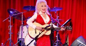Dolly Parton sings at the  Red Tent Women's Conference 2014 in Nashville, Tennessee in 2013. Photograph: Getty Images