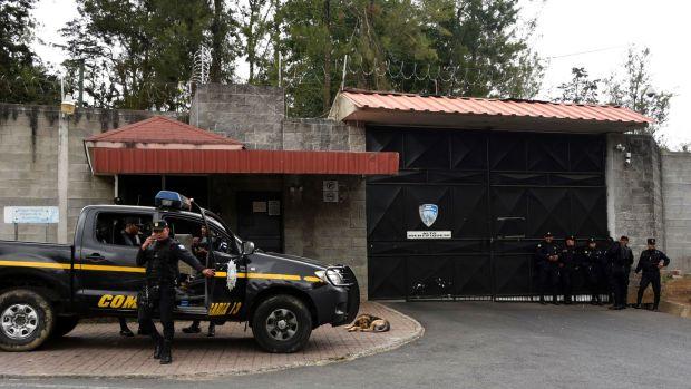 Police guard the entrance of Virgen de la Asuncion children's shelter after the March 2017 fire. Photograph: Johan Ordonez/AFP/Getty Images