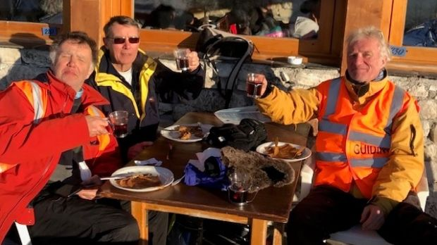 Peter Gorey (left) enjoys a well deserved pancake and vin chaud with his guides Roger Jones (centre) and Richard Waters (right).