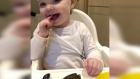 'Nice!' Baby Lena devours a plate of mussels