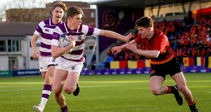 Luke McDermott crosses to score during Clongowes' win over CBC Monkstown. Photograph: Tommy Dickson/Inpho