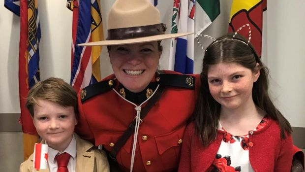 Nicky O'Brien's children Keelin (10) and Dillon (7) with the Canadian 'mountie' (police woman) after becoming citizens