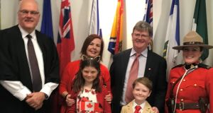 Nicky O'Brien, Pearse Cole and their children Keelin (10) and Dillon (7) with the judge and 'mountie' (police woman) after becoming Canadian citizens.