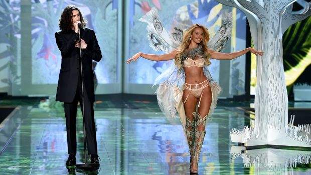Hozier performing as model Candice Swanepoel walks the runway during the 2014 Victoria's Secret fashion show in London. Photograph: Getty Images