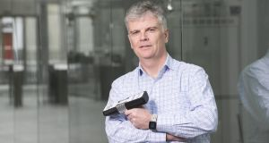 Prof Peter O'Brien of the Tyndall National Institute in Cork,with the new handheld device that uses biophotonics technology to detect early heart disease. It  can be used  by GPs in their surgeries.