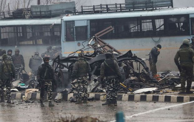 Indian security forces inspect remains of a vehicle following the car-bomb attack. Photograph: STR/AFP/Getty Images