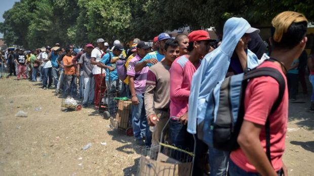Venezuelan migrants wait for food outside La Divina Pastora shelter in Villa del Rosario, Colombia, on February 13th, 2019. Photograph: Luis Robayo