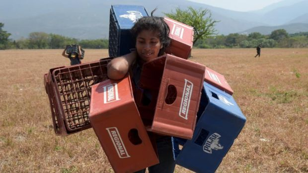 Venezuelan Dayana Pirela carries empty soda and beer crates to sell, after crossing from Venezuela through illegal trails in Villa del Rosario, Norte de Santander, Colombia on February 13th, 2019. Photograph: Raul Arboleda/AFP