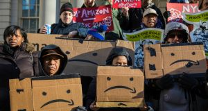 Protesters opposed to Amazon's  New York campus on the steps of city hall in New York. Photograph: Hiroko Masuike/The New York Times