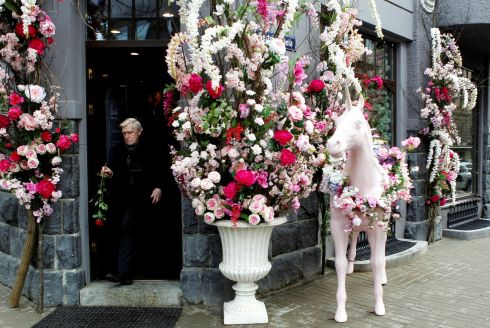 A flower shop decorated with a unicorn sculpture and bouquets of flowers on Valentine's Day in Riga, Latvia. Photograph: Toms Kalins/EPA
