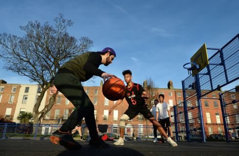 A spring in their step as locals play basketball in Mountjoy Square Park, Dublin. Photograph: Dara MacDonaill/The Irish Times