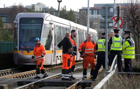 Gardai and Luas staff at the scene on Cookstown Way, near Tallaght, where a woman was killed in a collision with a tram at about 10am this morning. Photograph: Colin Keegan/Collins