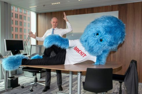 Dutch foreign minister Stef Blok and a hairy blue Brexit monster in The Hague. The government has enlisted a new ally in its battle to prepare businesses for the impending departure of Britain from the European Union, a hairy blue Brexit monster.  Photograph: Aad Meijer, Netherlands Foreign Ministry via AP