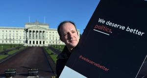 A protester holds a placard that reads 'We Deserve Better Politics' at Stormont. Photograph: Charles McQuillan/Getty Images