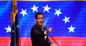 Venezuelan opposition leader and self -declared acting president Juan Guaidó: has vowed to bring in humanitarian aid despite President Nicolas Maduro. Photograph: Federico Parra