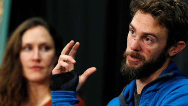 Travis Kauffman urged other runners not to listen to music while running because if he had been wearing them he might not have heard the pine needles rustle behind him, which alerted him to the mountain lion. Kaufman's girlfriend, Annie Bierbower, looks on. Photograph: David Zalubowski/AP