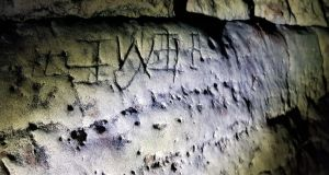 Some of the marks believed to protect against witches at Creswell Crags in the east Midlands. Photograph: Creswell Heritage Trust/Historic England