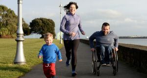 Running coach Mary Jennings with her husband John Fulham and their son Harry.  Photograph: Alan Betson/ The Irish Times
