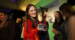 Kellie Harrington holds her award for  The Irish Times Sport Ireland Sportswoman of the Year  2018. 'Medals mean nothing to me. I'm just happy about the place I'm in right now, of how happy my family are, the person I've become.' Photograph: Nick Bradshaw