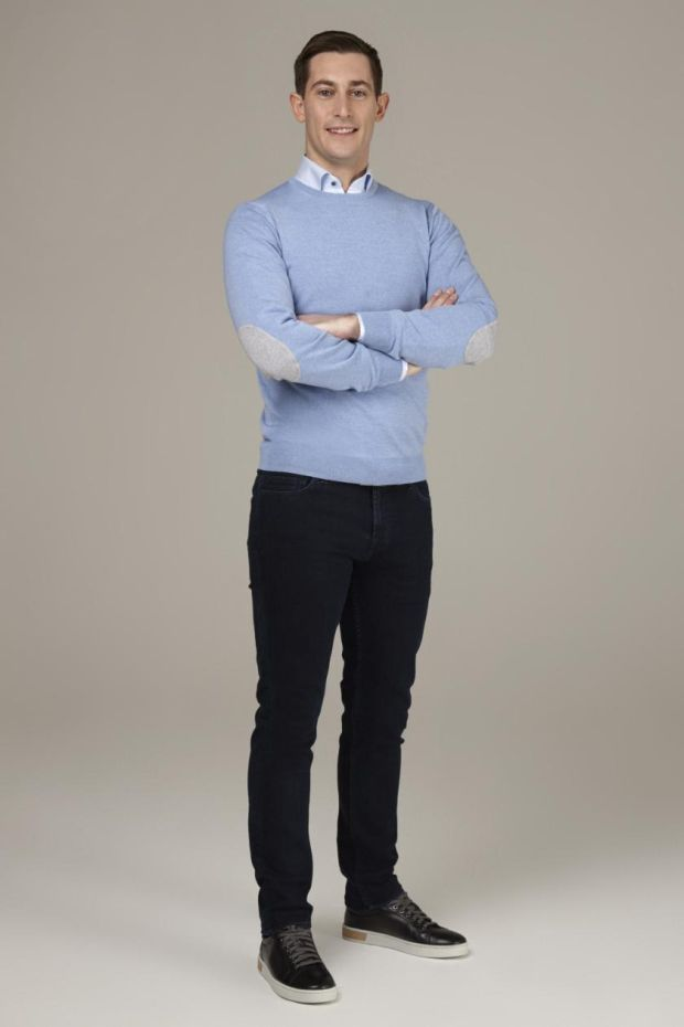 Darragh Collins wears blue crew neck sweater €139 by Stenstroms, jeans 7 for All Mankind €249, white shirt with floral inlay €159 by Stenstroms, belt €59 Louis Copeland, and black runners Magnanni €299.
