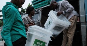Independent National Electoral Commission workers unload ballot boxes in southern Nigeria on Saturday after Nigeria's electoral watchdog postponed presidential and parliamentary elections just hours before polls were due to open. Photograph: Yasuyoshi Chiba/AFP/Getty Images
