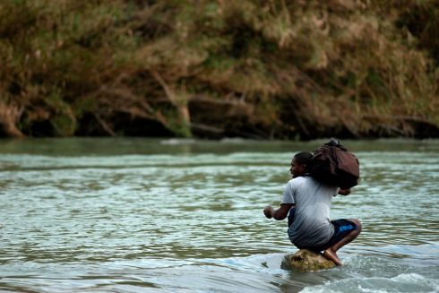 A Honduran migrant tries to cross the Rio Bravo. Photograph: Julio Cesar Aguilar/AFP