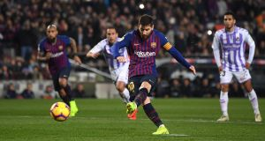 Lionel Messi  scores a penalty for Barceloan during the  the La Liga match against Real Valladolid  at the Nou Camp. Photograph: David Ramos/Getty Images