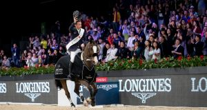 Denis Lynch and Chablis salute the crowd after winning the Longines Masters of Hong Kong Grand Prix. Photograph: Jessica Rodrigues