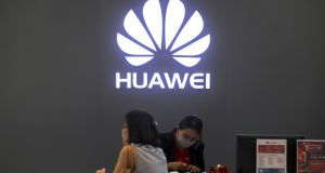 People in a Huawei shop in Bangkok, Thailand: Some network operators in Europe are warning  a Huawei ban could push back deployment of 5G by as much as three years. Photograph: Athit Perawongmetha