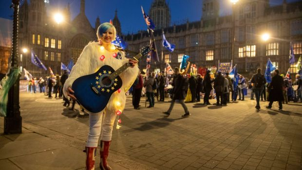 "Madeleine Kay or ""EUsupergirl"" outside the Palace of Westminster: The UK's inability to manage complexity has reached its nadir in recent months. Photograph: Steve Parsons/PA Wire"