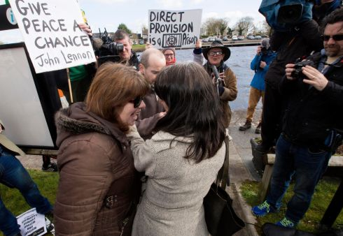 NO TO RACISM RALLY: An unidentified woman, who claimed to be from Rooskey, confronts one of the organisers of the Rooskey anti-racism demonstration, Leah Doherty. Photograph: Brian Farrell/Irish Times