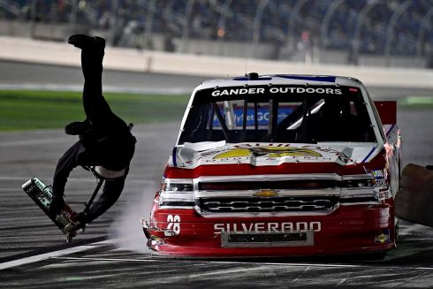 PIT CREW: NASCAR Gander Outdoors Truck Series driver Bryan Dauzat (28) hits a member of his crew in the pits during the NextEra Energy 250 at Daytona International Speedway in Florida, US. Photograph: Jasen Vinlove/USA Today Sports
