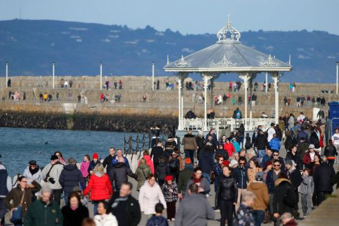 SUNSHINE: Sunday strollers enjoying the sunshine in Dun Laoghaire on Sunday afternoon. Photograph Nick Bradshaw/The Irish Times
