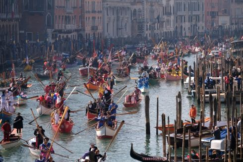 Venetians row during the masquerade parade on the Grand Canal during the Carnival in Venice, Italy on February 17th. Photograph: Manuel Silvestri/Reuters