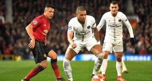 Alexis Sanchez of Manchester United  closes down Kylian Mbappe of PSG during the Champions League defeat to the French side at Old Trafford. Photograph: Photograph:  Michael Regan/Getty