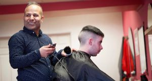 Barber Sajjad Hussain cuts hair in his  shop in Ballaghaderreen, Co Roscommon. Photograph:  Brian Farrell.